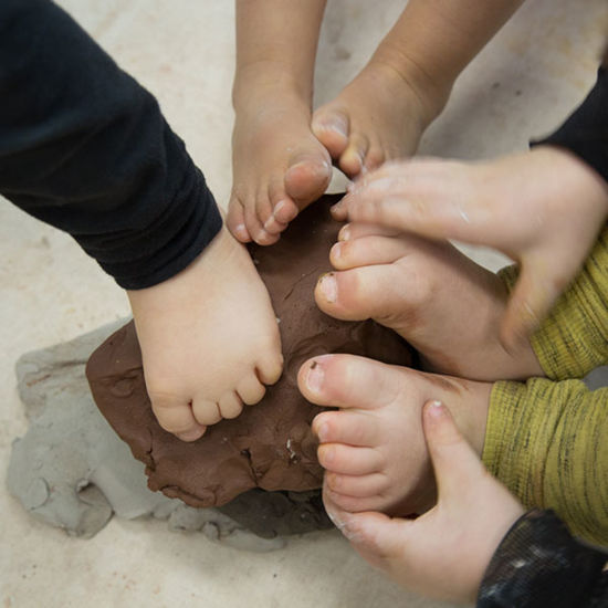 childrens feet on modeling clay