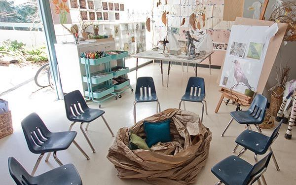 early years centre with chairs in a circle and a nest in the middle made of paper